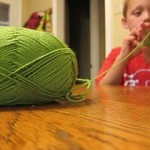 child knitting