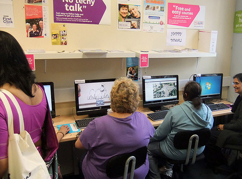 Women learn computer skills. Photo by Spark Creative Ltd on Flickr