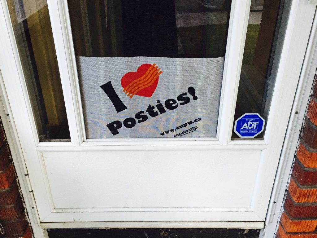 Front door of a house with I Heart Posties sign
