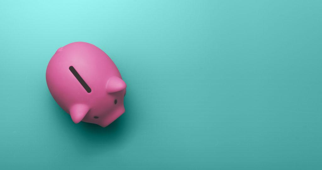 Piggy bank on green backdrop