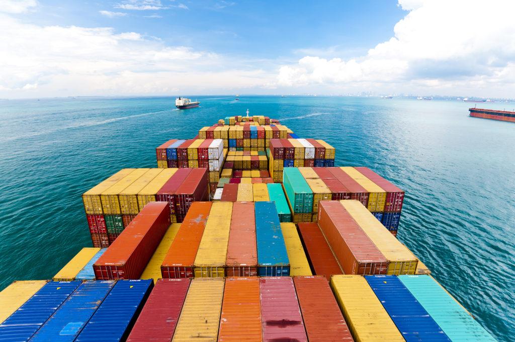 Cargo ships entering a port