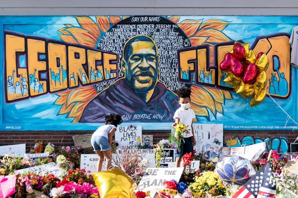 A mural outside Cup Foods in Minneapolis, Minnesota commemorates the life of George Floyd, the 46-year-old African American man who was killed by asphyxiation under the knee of police officer Derek Chauvin on May 25, triggering worldwide protests against anti-Black police violence. The mural, by artists Xena Goldman, Cadex Herrera and Greta McLain, has become a popular spot to visit and be photographed in front of.